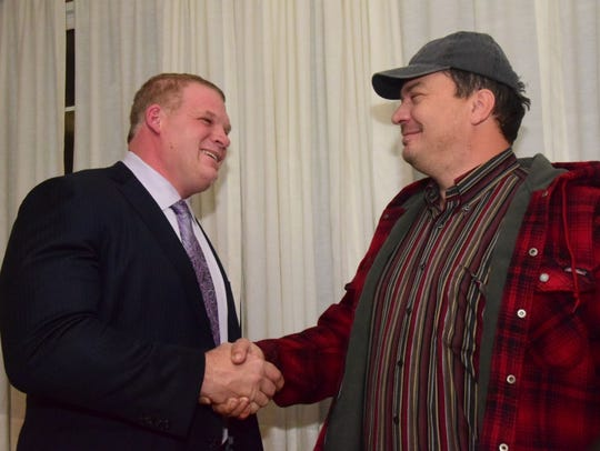 Mayoral candidate Glenn Jacobs shakes hands with Knox County businessman Brad Mayes.