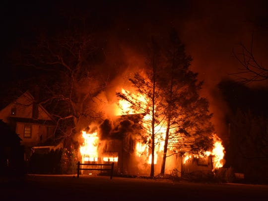 Firefighters battle a blaze at a Stewartstown garage Tuesday, Jan. 17. Photos courtesy of South County Fire Photos.