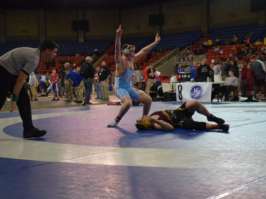 Paxton Ervin celebrates a victory during the tournament.