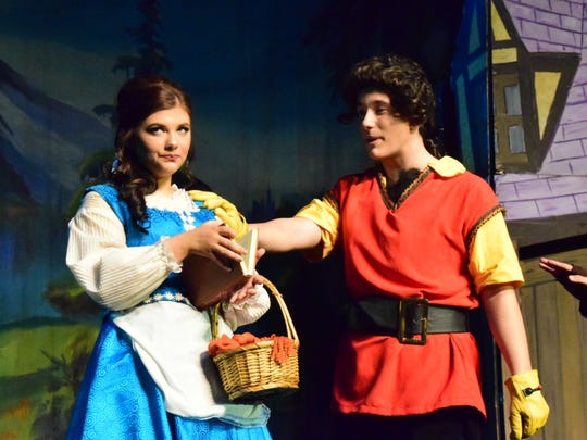 Gaston (Justin West) tries to win over Belle (Hanna