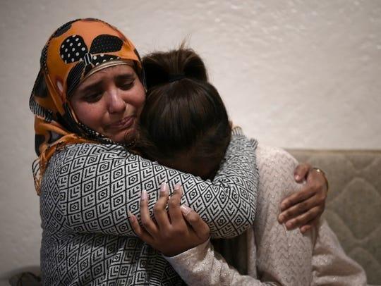 Rojina Akter hugs her daughter, Evana, a nursing student