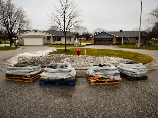 Sandbags were distributed to some Port Huron neighbors following a flood watch.