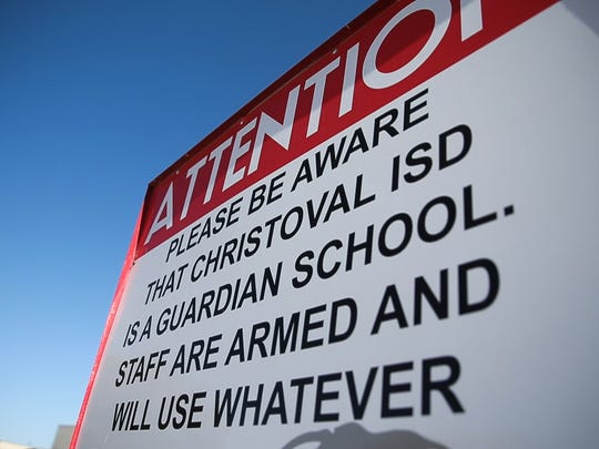 A sign warns visitors that Christoval staff are armed