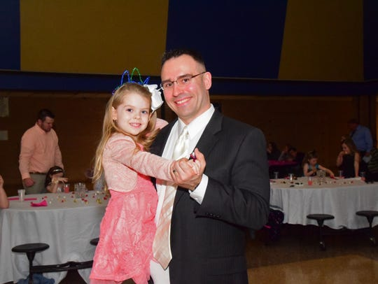 Savannah Grace Leitch, 5, dances with her father, Britton