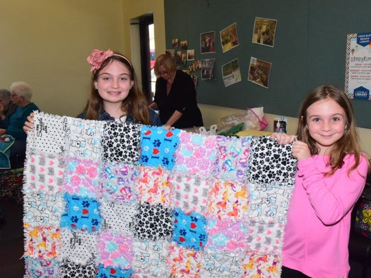 Cailyn Collins, 11, and Briann Collins, 8, show off