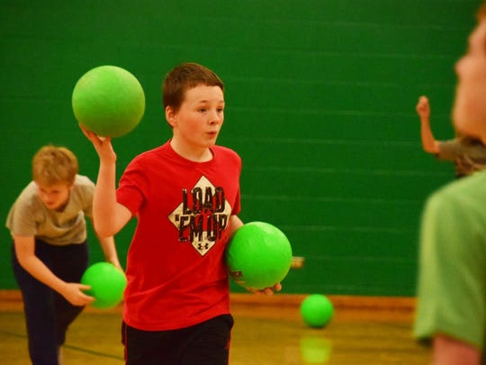 Caden Bolton, 11, takes aim during a game of Scatterball, a less aggressive game similar to Dodgeball.