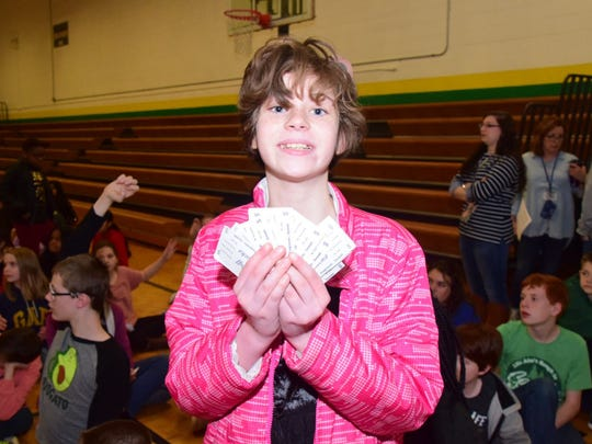 Vivian Rickerson, 12, shows off the Bucks she earned with good behavior at Cedar Bluff Middle School. She traded her Bucks for goodies at the Behavioral Bonanza held at the school Friday, March 9.