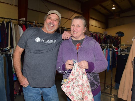 "Daniel Acosta with wife Marjorie prepare for ""shoppers"" at the monthly Clothes Closet hosted by Friendship Baptist Church, 8307 Ball Camp Pike, on Wednesday, March 14."