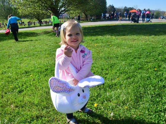 Scarlett Tuesburg, 2, is all smiles filling her Easter