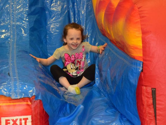 Loralie Oxendine, 4, said the inflatable slide was her favorite part of Spring Fling.