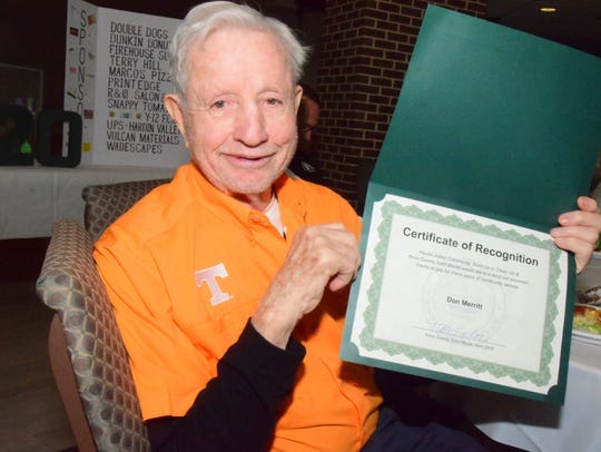 Don (Papa Don) Merritt receives a certificate of recognition