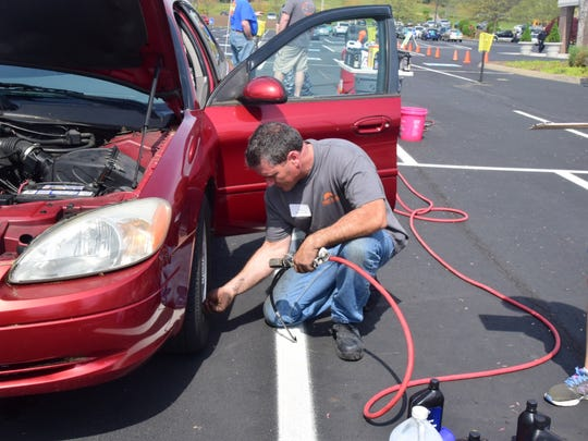 Volunteer Terry Beverwyk checks the tire pressure as