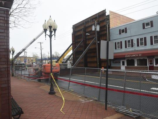 Crews face a delicate demolition process at 109 E.