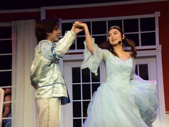 Prince Charming (Lee Pinkston) falls in love with Cinderella (Olivia Asano) while dancing at the ball.