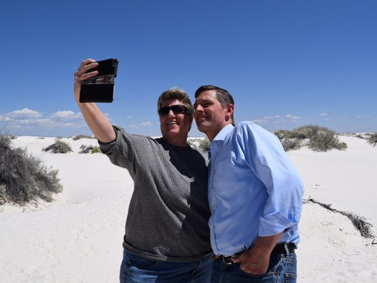 Las Cruces Green Chamber President Carrie Hamblen takes a photo with Heinrich inside the dunes on Friday afternoon.