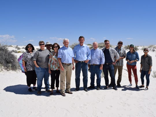 State Sen. Ron Griggs, U.S. Senator Martin Heinrich and community members enjoy the gypsum dunes on Friday afternoon.