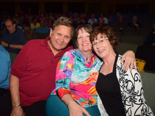 "Guy Penrod fans John Ptacek, Manuela Ptacek and Bonnie Branch. ""I've been involved with Fostering Hope from the beginning. What they're doing is amazing. There are so many things foster kids need that people don't think about, like suitcases,"" said Manuela Ptacek."