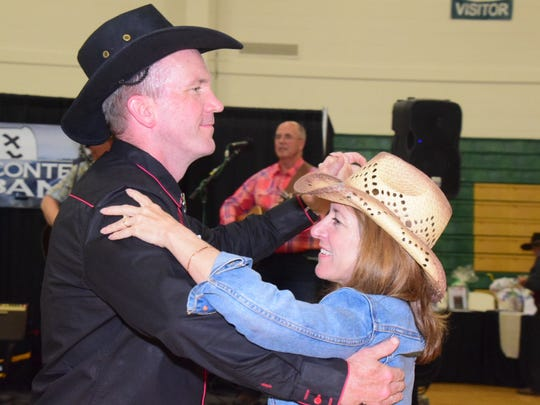 """Scott and Glinda Inman dance to """"The Tennessee Waltz"""" played by Mount LeConte Jug Band."""