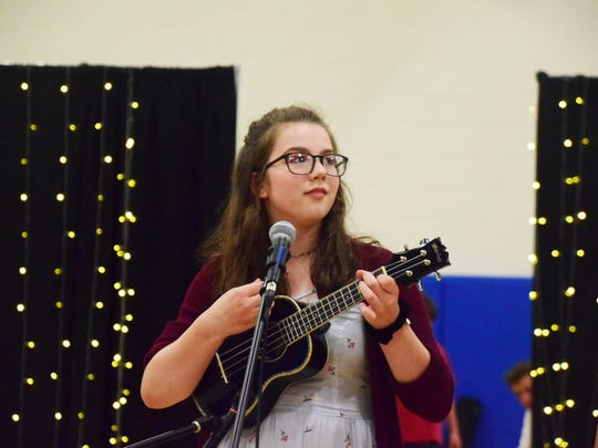 """Meg Pinkston, 13, plays the ukulele and sings """"Ho Hey!"""""""
