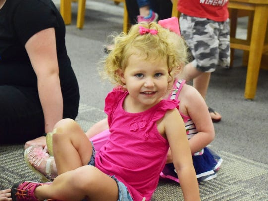 Leona Faye Stottler, 4, waits for the show to begin.