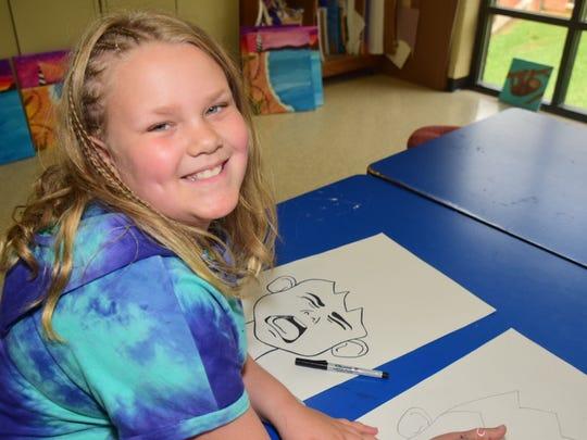 Hannah Riseden, 10, tries her hand at cartooning.