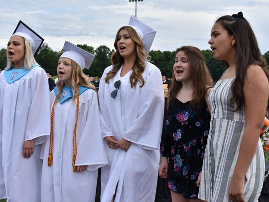 Students sing the national anthem before Marlboro's 2018 graduation at the high school.