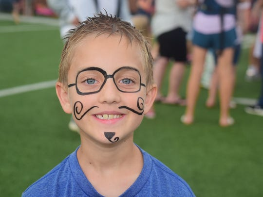 Chase Cline, 8, is all smiles in his dastardly beard