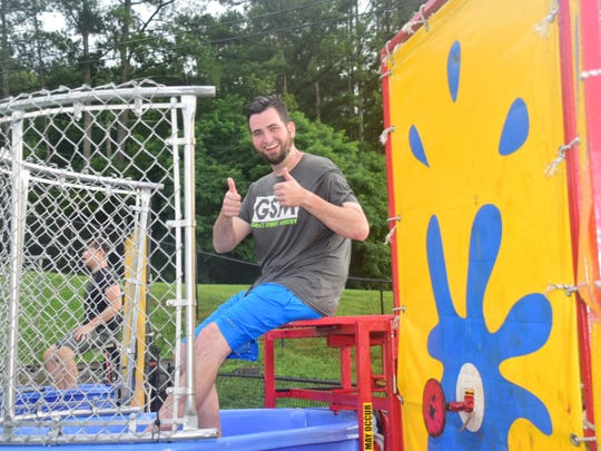 Associate Student Pastor Bryan Thomas prepares to go under in the dunking booth.
