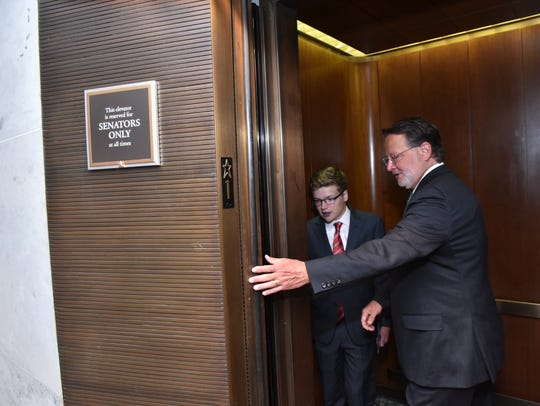 Sen. Gary Peters and Thomas Stephenson, 18, of Greenville, enter a 'Senators Only' elevator on Capitol Hill. Stephenson is a 'Senator for a Day,' shadowing Peters in partnership with the Make-A-Wish organization.