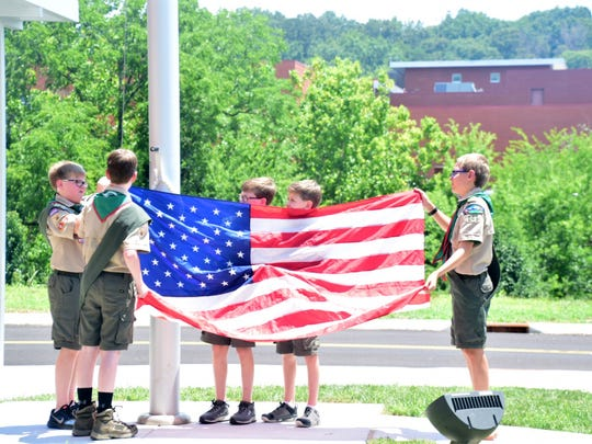 Hardin Valley Boy Scout Troop 246 raises the flag for the Pledge of Allegiance led by the Hardin Valley Middle School cheerleaders.