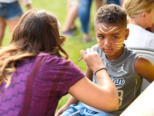 Malik Reid, 6, gets his face painted on Family Night