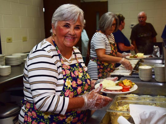 Patty Underwood serves up a delicious meal at the Dona Bean Fundraiser for Children held at Beaver Ridge United Methodist Church on Wednesday, July 18.