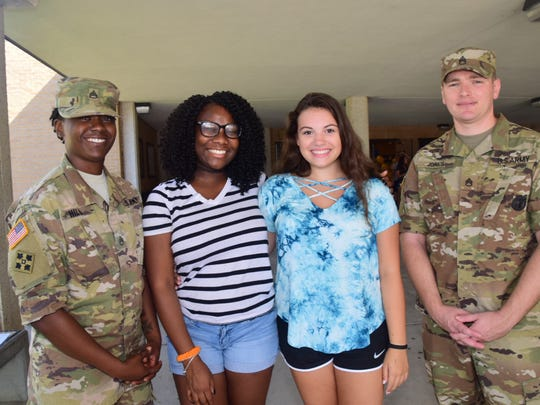 """Staff Sgt. Nilaja Hill, Raniyah Groden, 14, Lily Mitchell, 15, and Staff Sgt. Timothy Jones talk about career opportunities in the Army and Army Reserves at Welcome Back Beaver Day held at Karns High School Tuesday, Aug. 6, 2018. """"You're never too young to start planning,"""" said Hill."""
