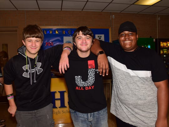 Alex Thompson, 15, Logan Waldrop, 16, and Cameron Mason,