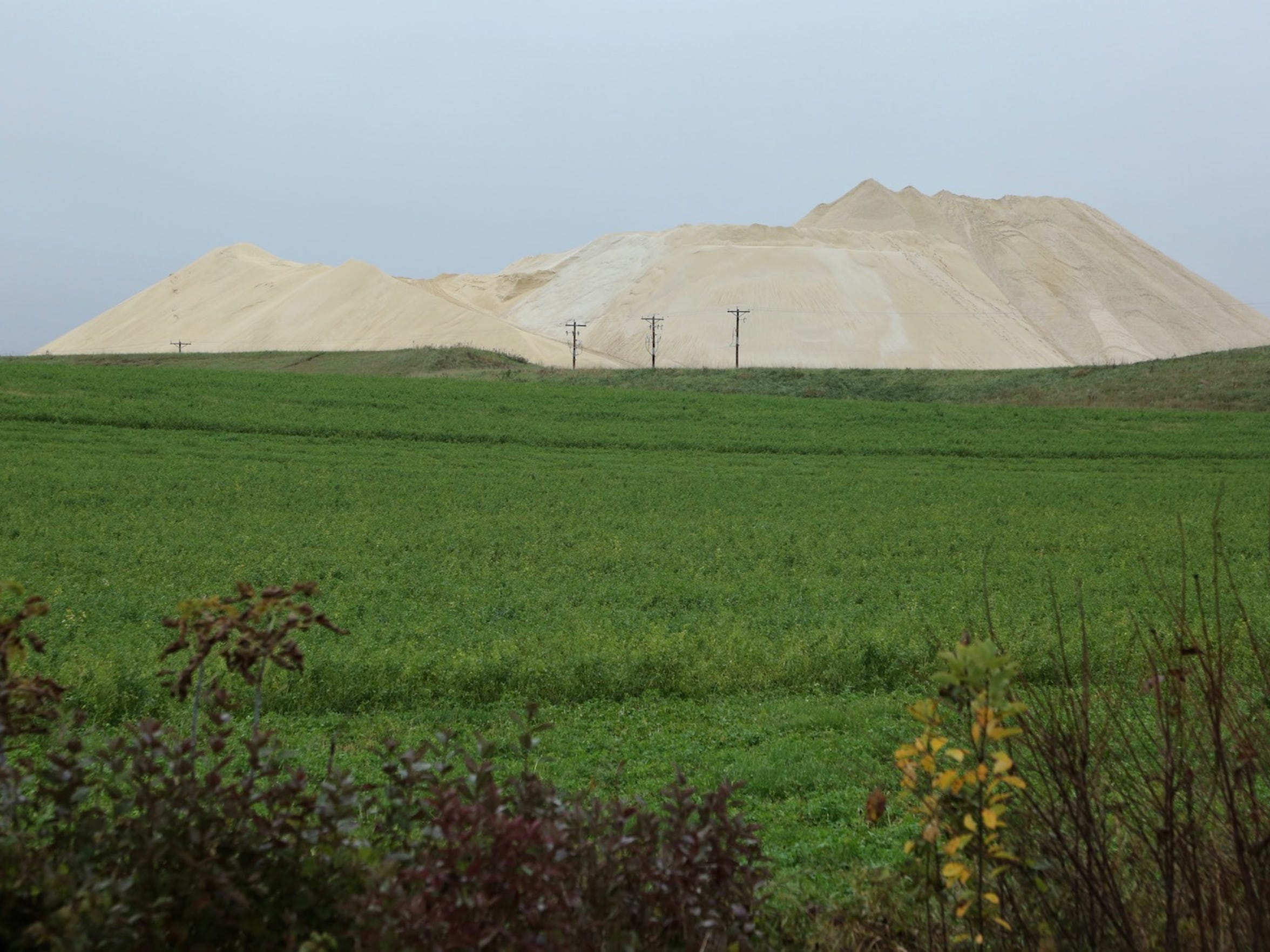 A frac sand mine casts a long shadow near Augusta, Wis.