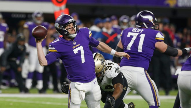 Minnesota Vikings quarterback Case Keenum (7) is pressured by New Orleans Saints defensive end Cameron Jordan (94) as he throws during the second half of an NFL divisional football playoff game in Minneapolis, Sunday, Jan. 14, 2018. (AP Photo/Jim Mone)