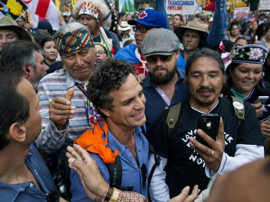 Actor and activist Mark Ruffalo (center, left) and