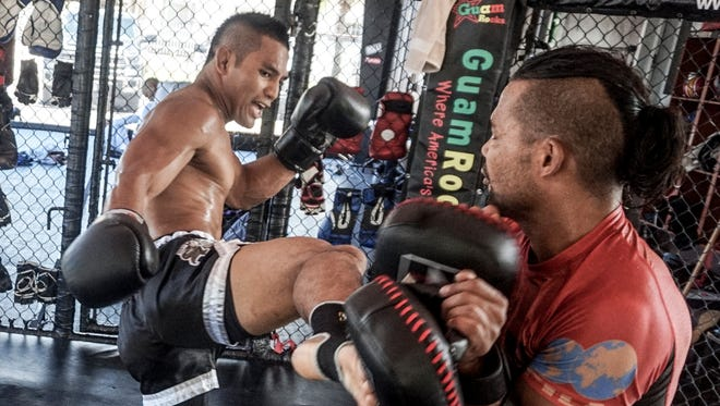 In this file photo, mixed martial arts and muah thai fighter Joe Gogo trains at Spike 22.