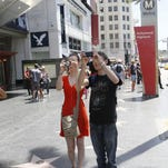 "In this 2013 file photo, Austrian tourists take photos on Hollywood's star-lined ""Walk of Fame"" in Los Angeles."