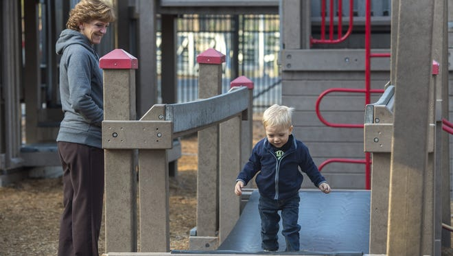 In this file photo, Ryker Adams, 2, and his grandmom, Tina Doak of Parsonsburg, enjoy an afternoon visit to Ben's Red Swings in Salisbury.