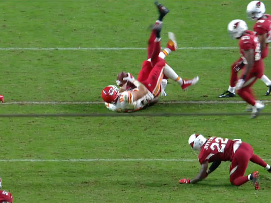 Kelce appears to have both hands on the ball.