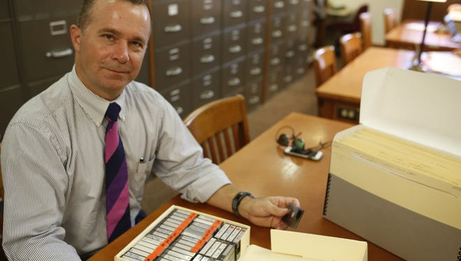 Professor Davis Houck shows off some tapes from a filmmaker's research now housed in the Emmett Till collection in the special collections room at Florida State's Strozier Library Nov 13.
