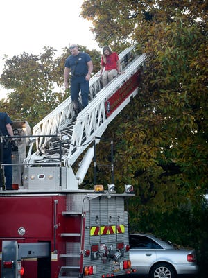 City of Lebanon firefighters responded to a call for assistance near 428 Walnut Street Thursday afternoon, Nov. 10. The fire department deployed a ladder to help a juvenile out of a tree. The young girl was greeted and hugged by her mother and what appeared to be friends as she climbed off the fire truck.