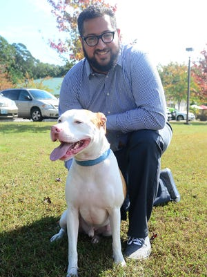 Mike Hindi, of Ocean Pines, and his dog Dallas survived Hurricane Maria while staying in Dominica in on September 21, 2017.