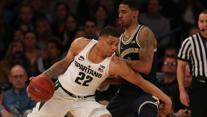 Michigan guard Charles Matthews defends against Michigan State guard Miles Bridges during second half action of the Big Ten Tournament semifinal Saturday, March 3, 2018 at Madison Square Garden in New York.