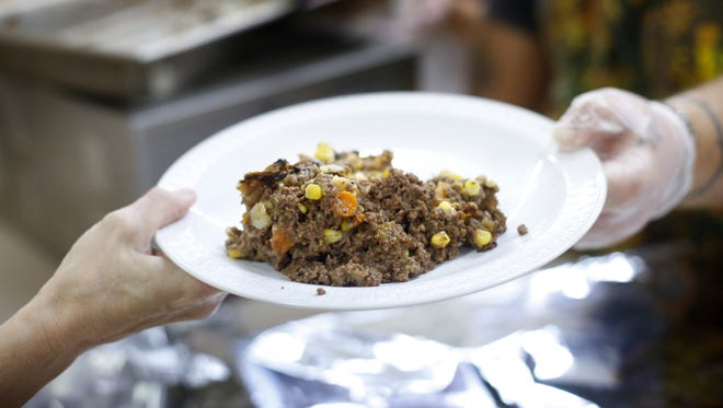 A plate of shepherd's pie made with venison and moose meat is served at a church dinner in Portland, Maine.