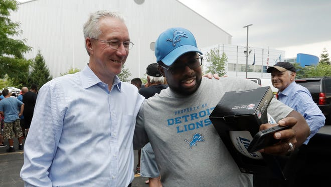 Detroit Lions fan Jason Blackmon takes a selfie with team President Rod Wood before practice at the NFL football teams training camp, Friday, July 29, 2016, in Allen Park, Mich.
