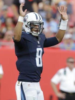 Titans quarterback Marcus Mariota (8) celebrates a touchdown during the second half Sunday.