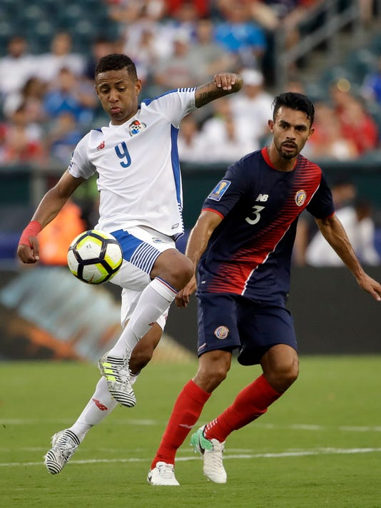 Panama's Gabriel Torres (9) and Costa Rica's Giancarlo Gonzalez (3) battle for the ball during a CONCACAF Gold Cup quarterfinal soccer match in Philadelphia, Wednesday, July 19, 2017. (AP Photo/Matt Rourke)