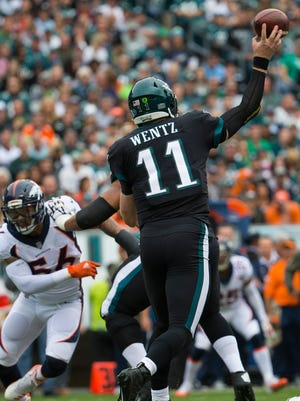Carson Wentz, one of the top candidates for the league's MVP award, throws downfield during the Eagles' 51-23 win over the Denver Broncos last Sunday at Lincoln Financial Field.